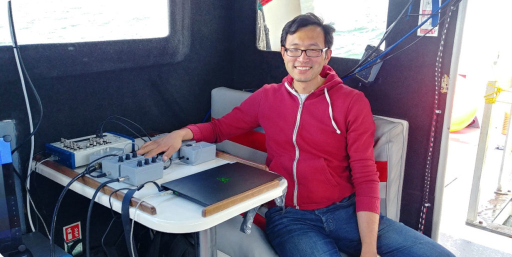 OSC Acoustician undertaking noise measurement of pile-driving noise from a vessel © OSC 2019.